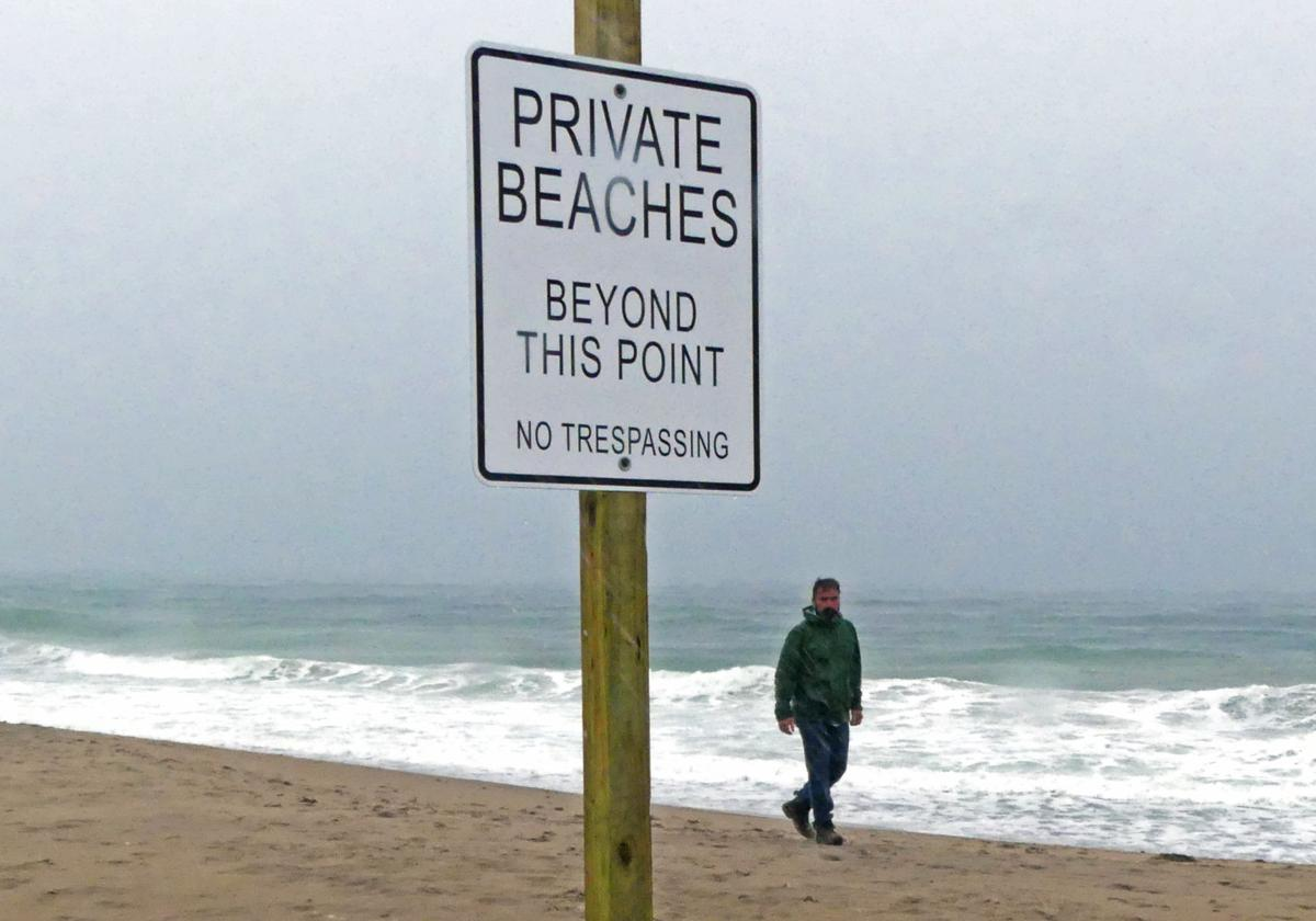 Private beach sign on public beach